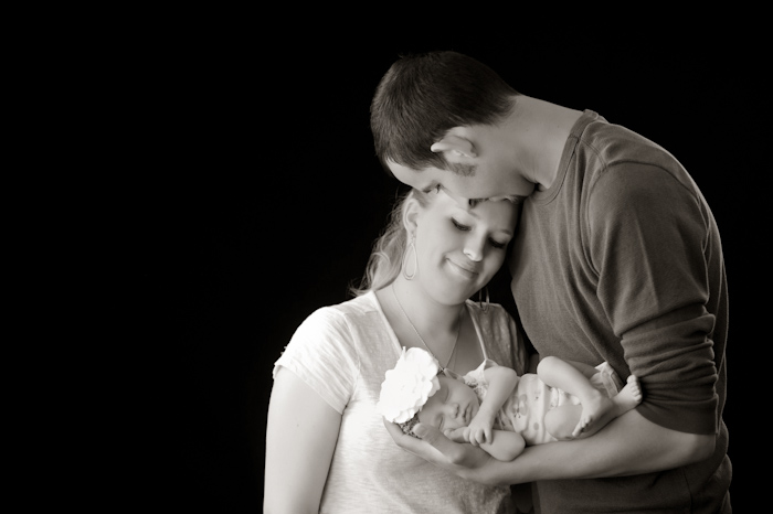 Happy family portrait with newborn baby girl
