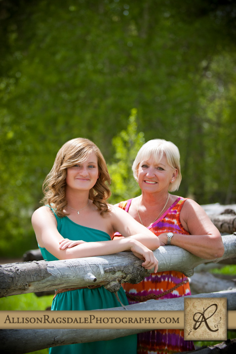 Mother and Daughter on Rustic Fence Picture