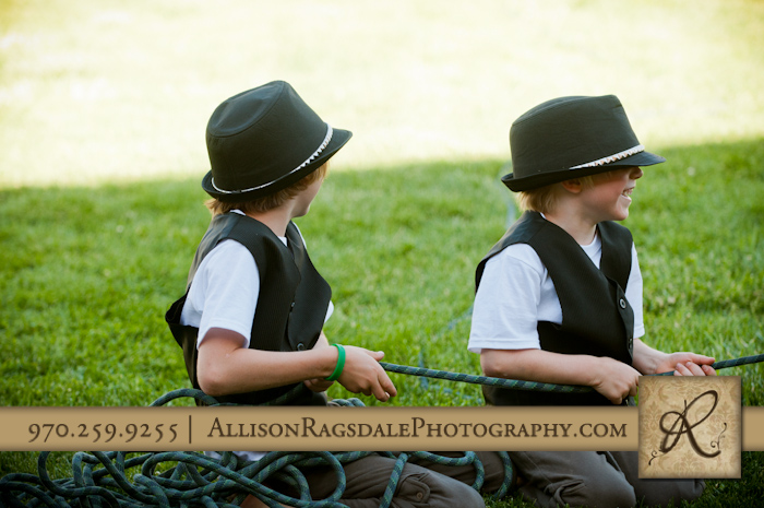 little boy brothers in matching oufits at wedding picture