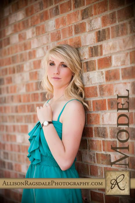 senior photo on brick wall