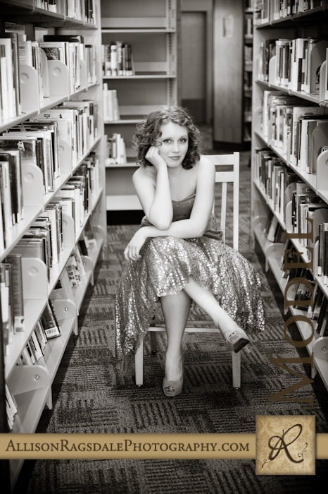 black and white senior picture with library books