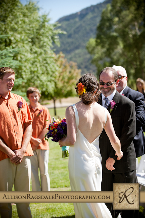 father giving bride away in wedding ceremony photo