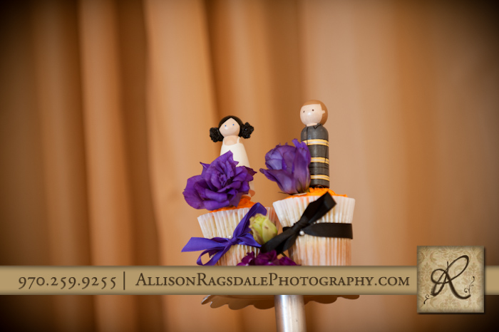 bride and groom cake toppers on cupcakes