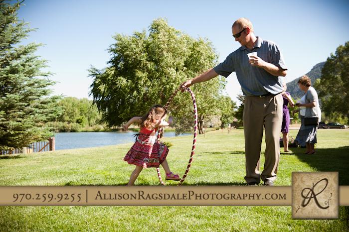 little girl jumping through hula hoop pic