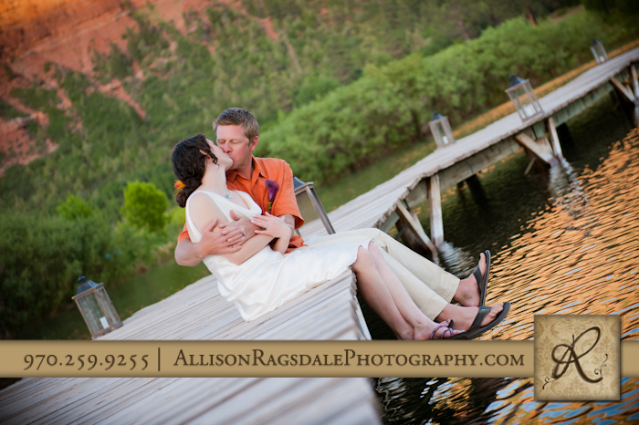 bride and groom kissing on dock at sleeping beauty ranch in durango pic