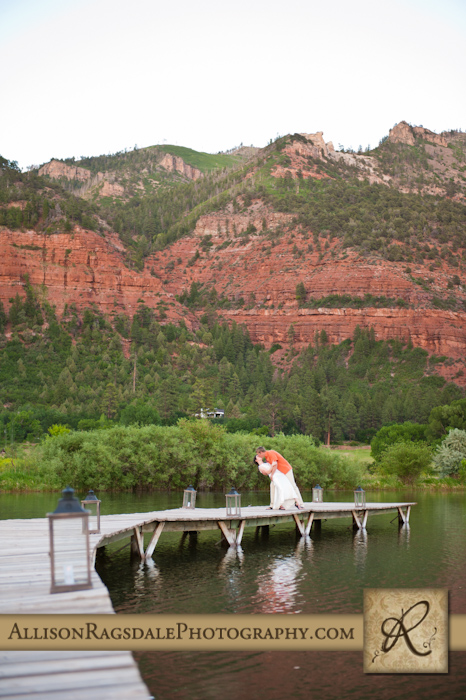 bride and groom with red cliffs wedding portrait
