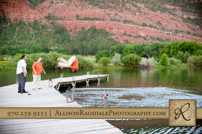 groom jumping into a lake at sleeping beauty ranch picture