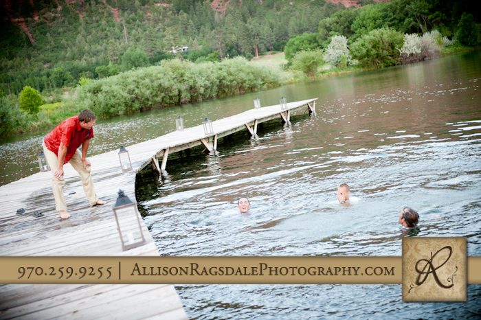 groom catching his breath jumping in lake