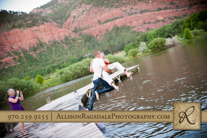 wedding guest jumping into lake with groomsman photo