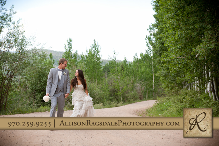 bride and groom walking up dirt road