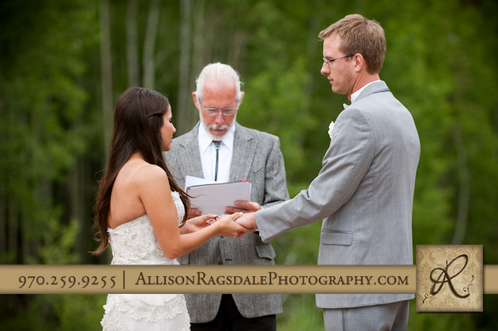 bride and groom exchanging rings and vows during wedding ceremony