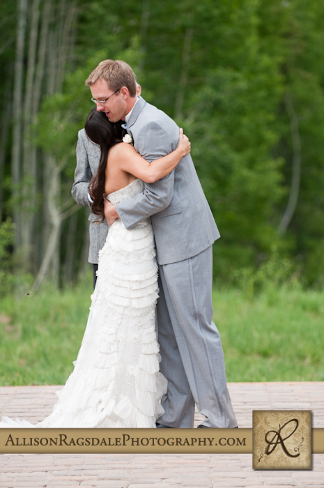 hug after first kiss during wedding ceremony
