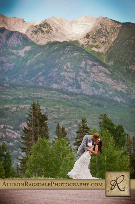 dramatic twilight mountain bride and groom portrait