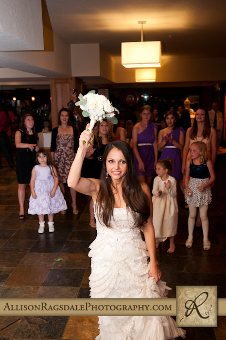 bride throwing bouquet at wedding reception for the single ladies
