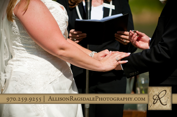 close up rings and hand shot at wedding ceremony