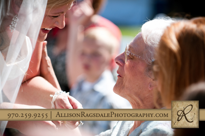 bride giving grandmother locket during wedding ceremony