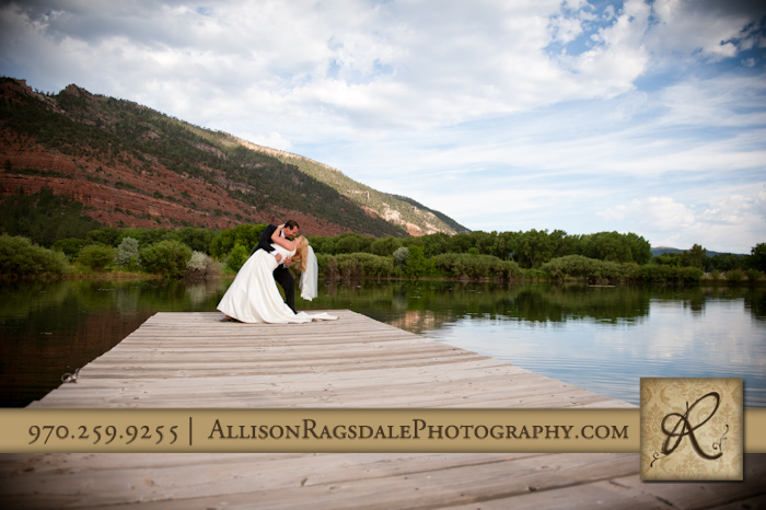 dramatic bride and groom portrait on dock at sleeping beauty ranch
