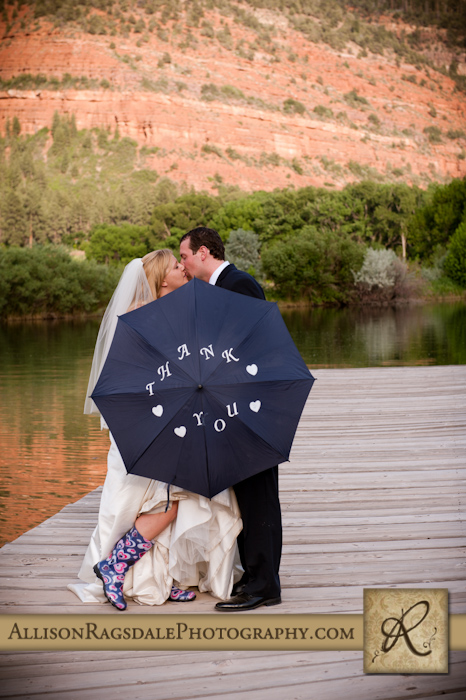 rainboots and umbrella bride and groom picture