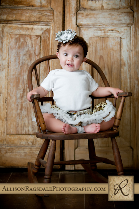 baby girl sitting in rocking chair pic