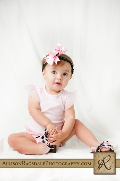 baby girl studio portrait in pink