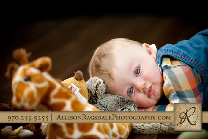 beautiful blue eyes on adorable baby boy in studio picture