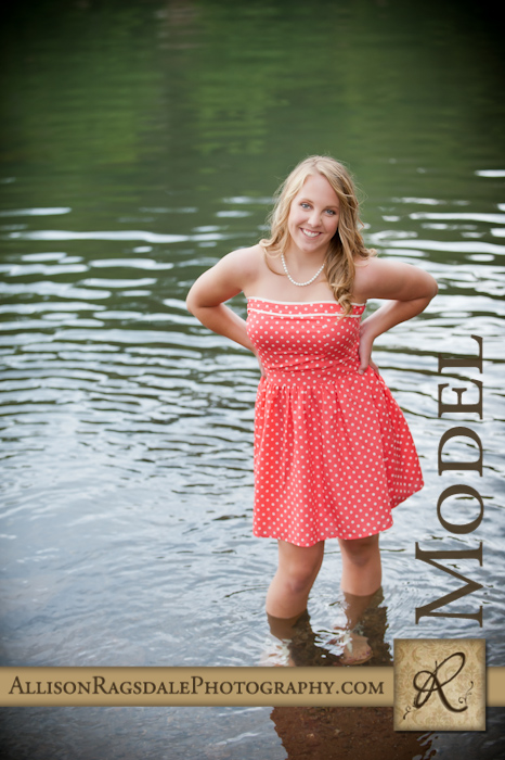 senior picture of girl in dress standing in animas river