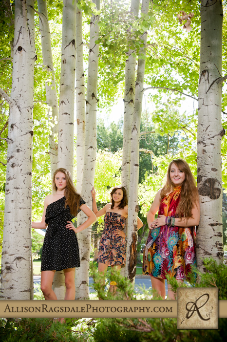 sisters in pretty dresses with aspen trees