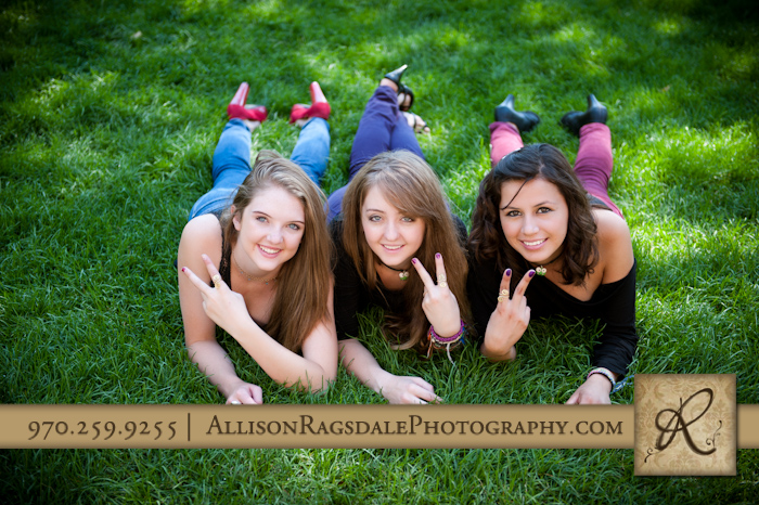 matching rings picture of three sisters laying in grass