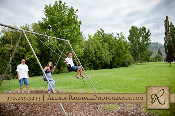 durango family swinging in the park photo
