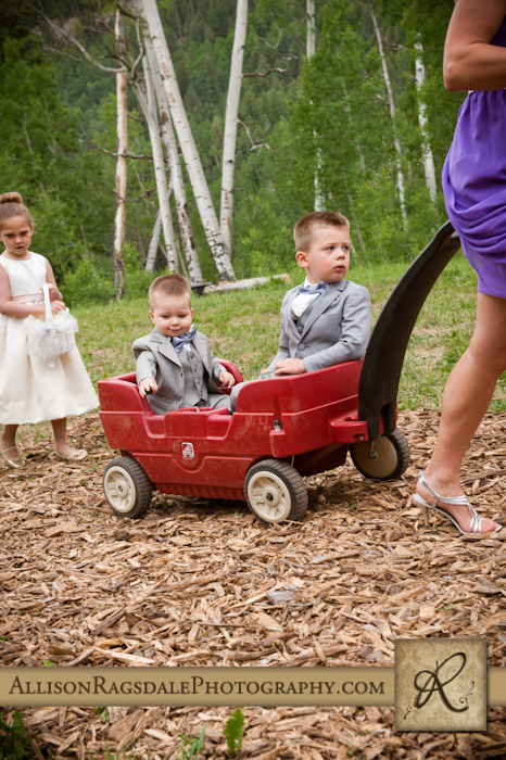 ringbearers in red wagon and flower girl for wedding ceremony