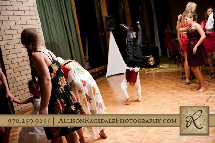 groomsmen doing handstand during wedding reception at double tree hotel in durango