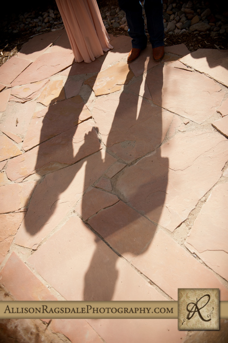 mother and father family photo in shadows on durango sandstone