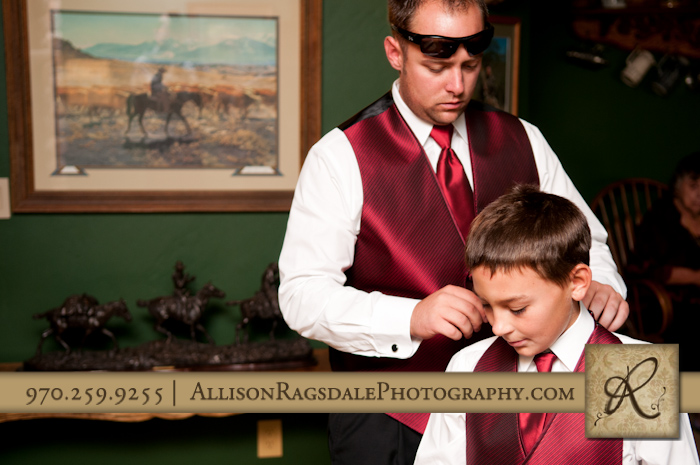 groom getting ready for wedding at thunder ridge in durango co