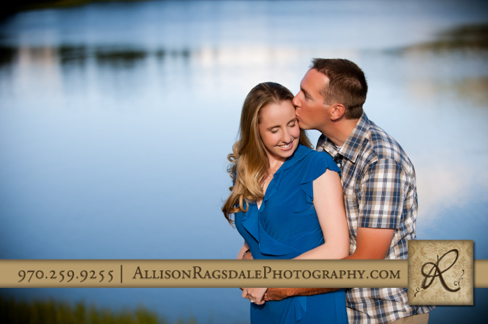 kissing engagement picture with andrews lake in background
