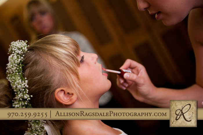 flower girl getting her make up done for wedding at glacier club in durango co