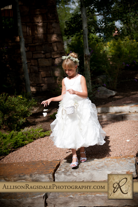 flower girl coming down aisle for wedding ceremony at glacier club durango co