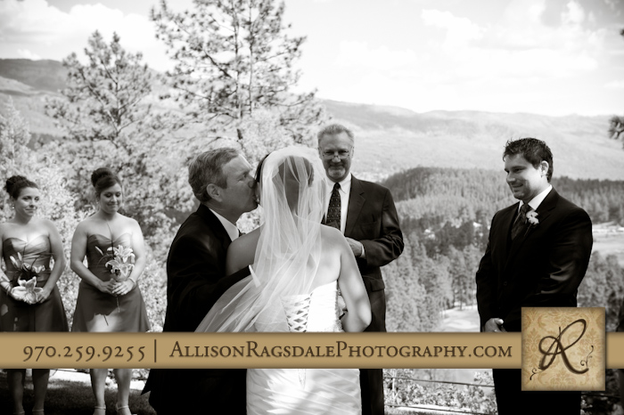 father giving away daughter at durango wedding ceremony at the glacier club
