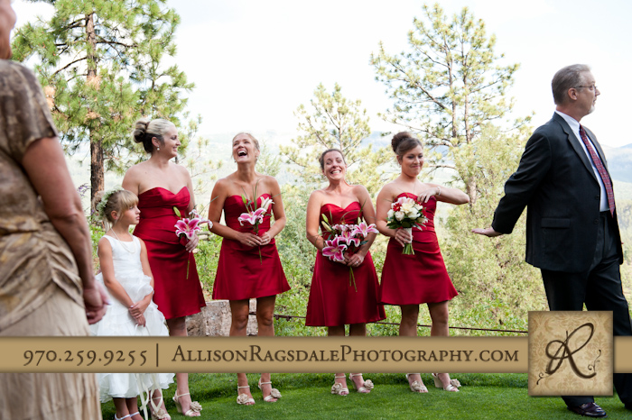 maid of honor handing ring to officient during wedding ceremony durango co