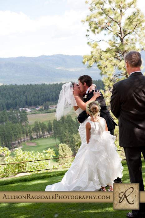 first kiss at wedding ceremony as daughter looks on at glacier club durango