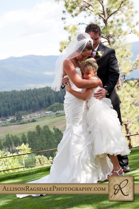 family hug at glacier club durango wedding ceremony