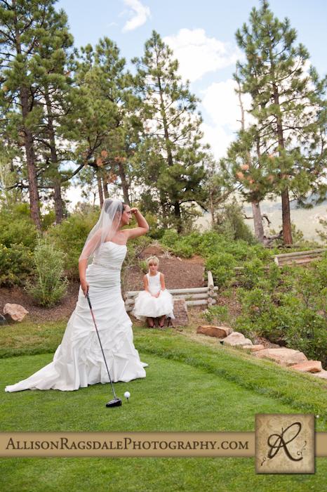 bride playing golf at the glacier club for a durango wedding