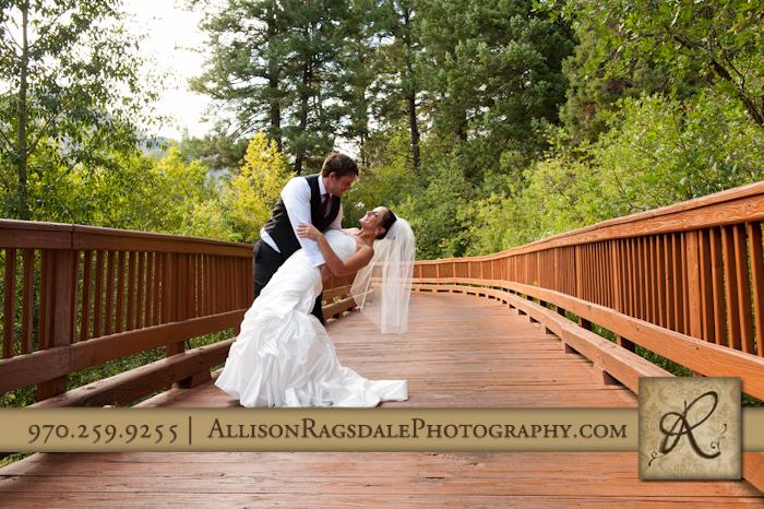 bride and groom dip on bridge at wedding at the glacier club in durango