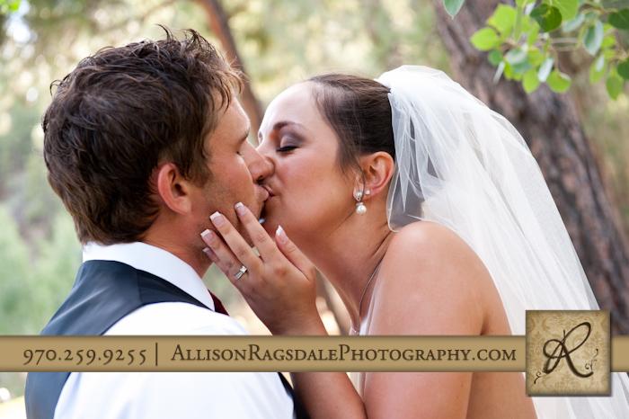bride and groom kiss at the glacier club wedding in durango colorado