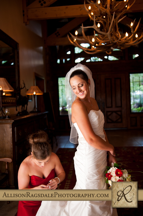 bride being bustled for wedding reception at the glacier club in durango