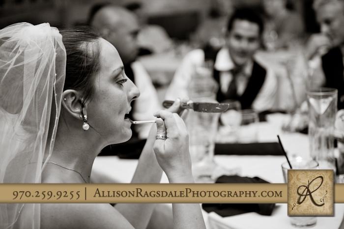 bride touching up makeup at wedding reception at the glacier club