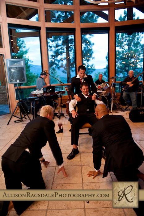 groomsmen dance for the groom at glacier club wedding reception in durango co