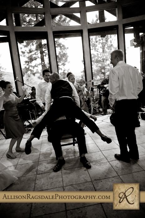 groomsmen dance at wedding reception in durango co at the glacier club