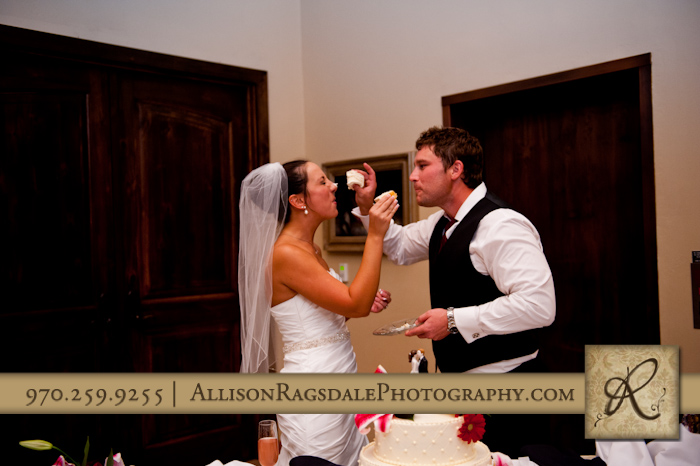 newlyweds cutting cake at wedding reception at the glacier club in durango