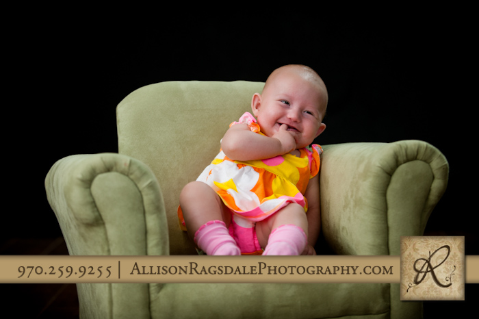 colorful dress in green armchair baby girl picture