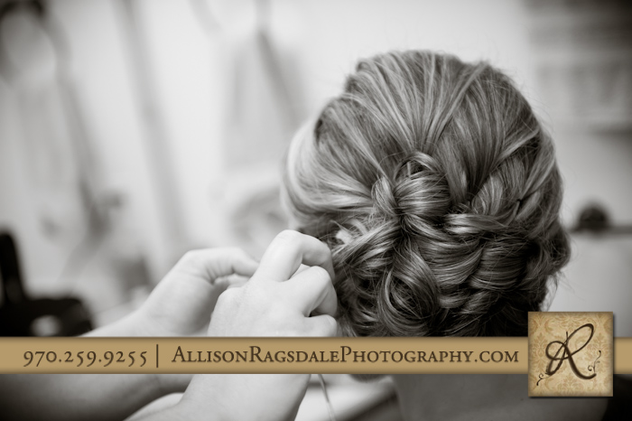 bride getting hair done for wedding ceremony at thunder ridge durango co